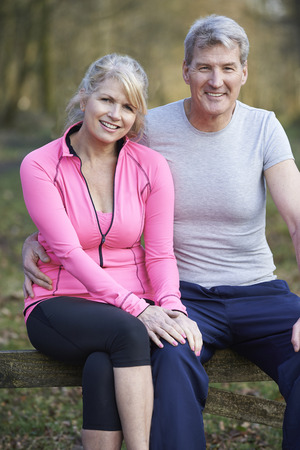 middle age: Mature Couple Exercising In Countryside Together