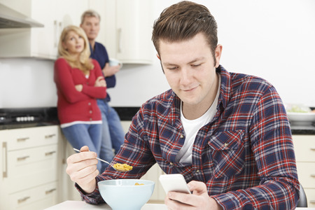 middle adult: Mature Parents Frustrated With Adult Son Living At Home