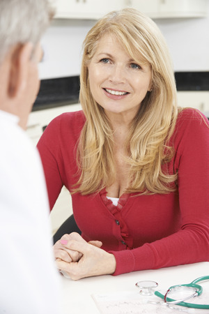 Mature Woman Meeting With Doctor In Surgery