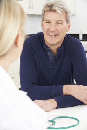 reassurance: Mature Man Meeting With Female Doctor In Surgery