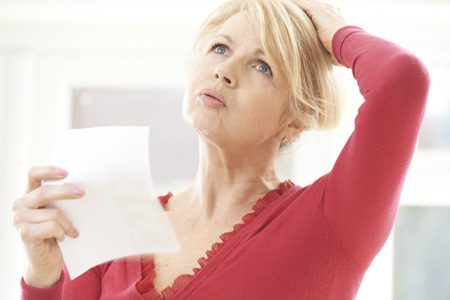 woman middle age: Mature Woman Experiencing Hot Flush From Menopause