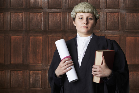 brief: Portrait Of Female Lawyer In Court Holding Brief And Book