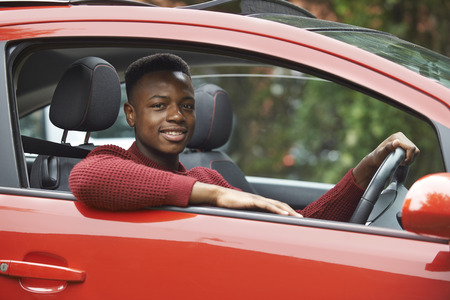 boy 18 year old: Male Teenage Driver Looking Out Of Car Window Stock Photo
