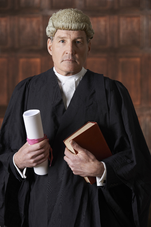 libel: Portrait Of Male Lawyer In Court Holding Brief And Book