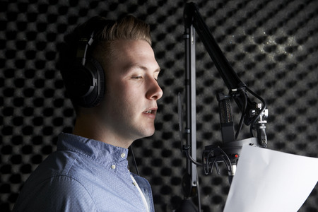Man In Recording Studio Talking Into Microphone