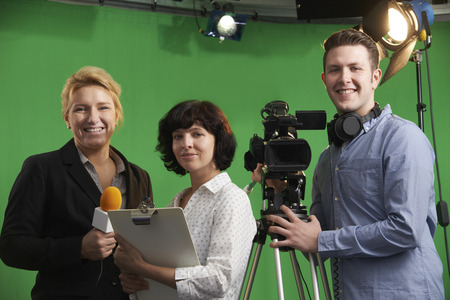 broadcasting: Portrait Of Cameraman With Presenter And Floor Manager In Television Studio