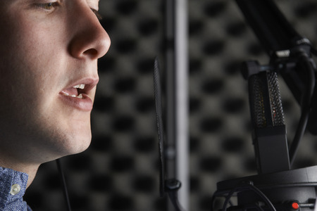 scripts: Man In Recording Studio Talking Into Microphone
