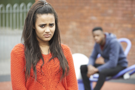 mixed race teen: Portrait Of Unhappy Teenage Couple In Urban Setting