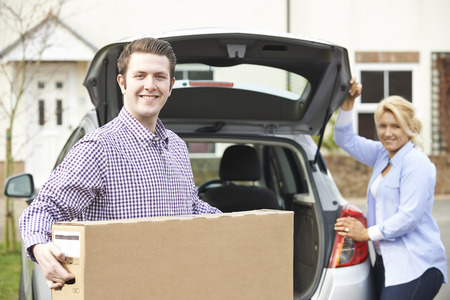 carrying box: Couple Unloading New Television From Car Trunk