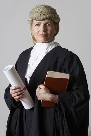 defendant: Portrait Of Female Lawyer Holding Brief And Book