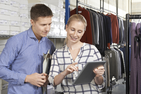 retail: Couple Running On Line Fashion Business Stock Photo