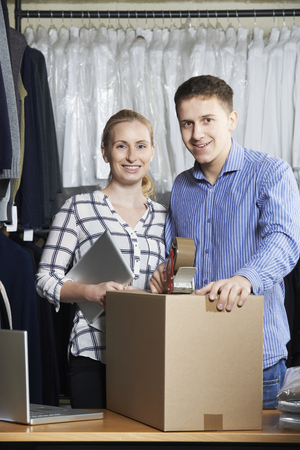 dispatch: Couple Running Online Clothing Store Packing Goods For Dispatch