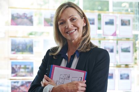 female  person: Portrait Of Female Estate Agent In Office Stock Photo