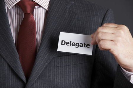attaching: Businessman Attaching Delegate Badge To Jacket