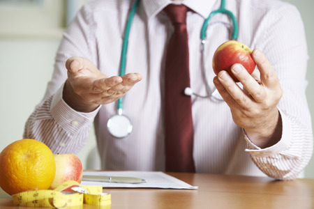 advies: Doctor Giving Advice On Healthy Diet