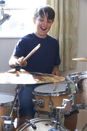 drum kit: Boy Playing Drum Kit At Home