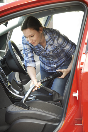 valeting: Woman Cleaning Inside Of Car Using Vacuum Cleaner