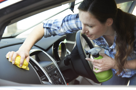valeting: Woman Cleaning Interior Of Car