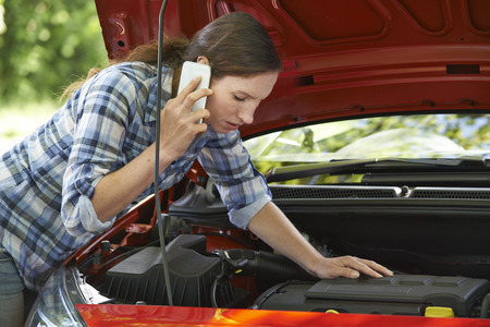 recovery: Female Motorist Phoning For Help After Breakdown