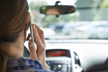Woman In Car Talking On Mobile Phone Whilst Driving Imagens - 46020047
