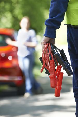 breakdown: Mechanic Attending Car Breakdown On Country Road