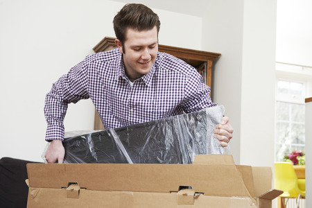 unwrapping: Man Unpacking New Television At Home