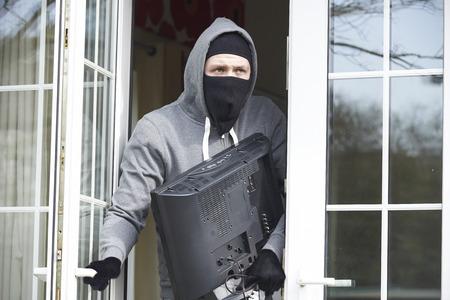 burglar: Burglar Breaking Into House And Stealing Television