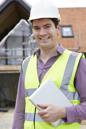 high visibility: Architect On Building Site Using Digital Tablet