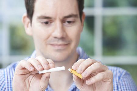 stop smoking: Man Using Electronic Cigarette To Stop Smoking