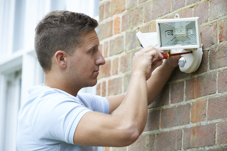 light house: Security Consultant Fitting Security Light To House Wall