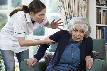 home care: Care Worker Mistreating Senior Woman At Home
