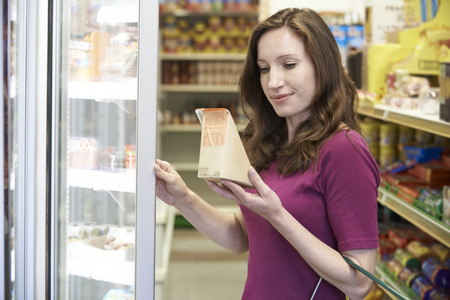 food shelf: Woman Buying Sandwich From Supermarket