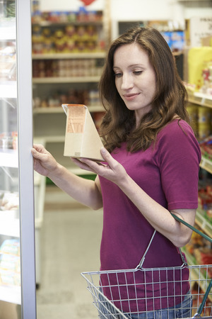 nutrition label: Woman Buying Sandwich From Supermarket