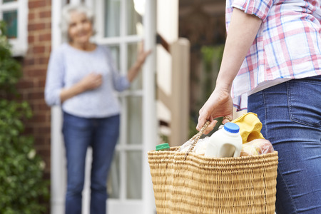 an elderly person: Person Doing Shopping For Elderly Neighbour