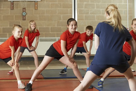 class a: Teacher Taking Exercise Class In School Gym