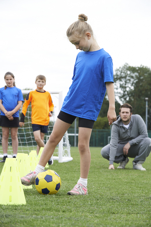 four classes: Coach Leading Outdoor Soccer Training Session