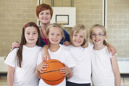 Teacher With Girls School Basketball Team photo