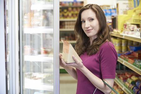 shopping binge: Woman Buying Sandwich From Supermarket