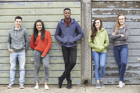smiling teenagers: Gang Of Teenagers Hanging Out In Urban Environment Stock Photo