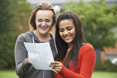 exam results: Two Female Students Celebrating Exam Results Together