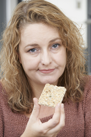 fedup: Bored Woman On Diet Eating Crispbread At Home