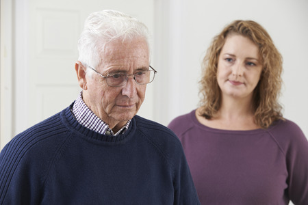 female senior adults: Serious Senior Man With Adult Daughter At Home