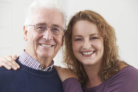 Portrait Of Smiling Senior Man With Adult Daughter Stock Photo