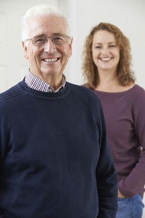 adult offspring: Portrait Of Smiling Senior Man With Adult Daughter