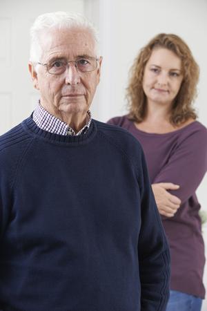 senior adult man: Serious Senior Man With Adult Daughter At Home