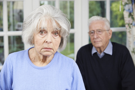 the ageing process: Unhappy Senior Couple At Home Together