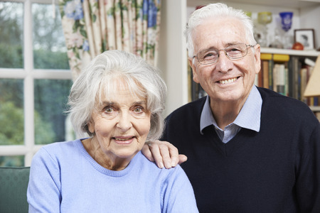 elderly adults: Portrait Of Happy Senior Couple At Home Together