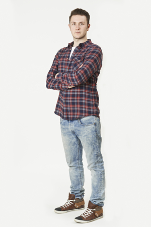 casual clothing: Full Length Portrait Of Man Standing In Studio On White Background