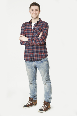 portrait studio: Portrait Of Man Standing In Studio On White Background Stock Photo