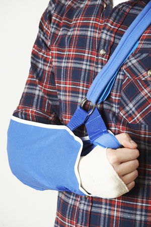 man arm: Close Up Of Young Man With Arm In Sling Stock Photo